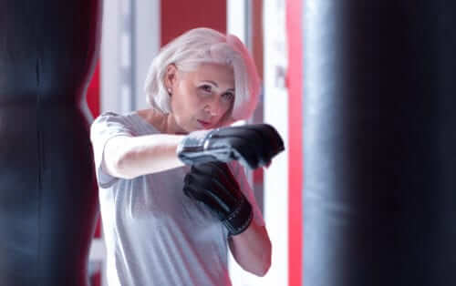 Older Woman Boxing and Exercising